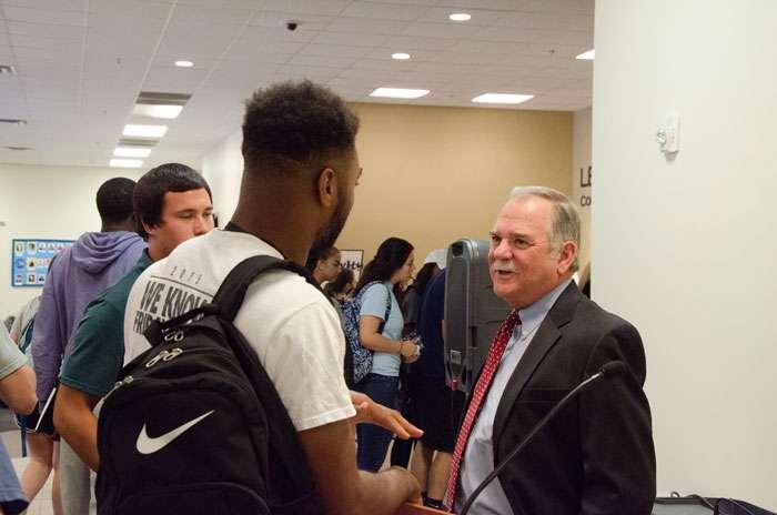 Buddy Bennett talks with students