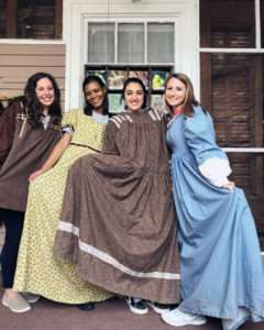 Juniors (from left) McKenna Massengill, Cherry Sullivan, Nancy Flores, and Abigail Kiser try on period clothing at Chieftains Museum.
