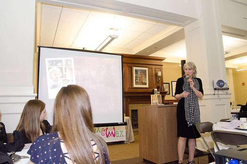 Connie Carey speaking at the Little Black Dress Tea