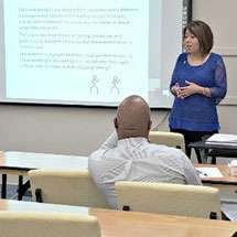 Dr. Dana King teaching in classroom.