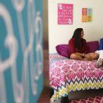 Two girls in dorm room talking