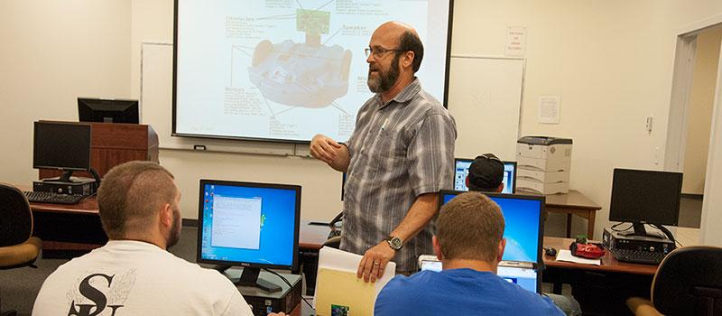 Dr. Anthony Nichols teaching class