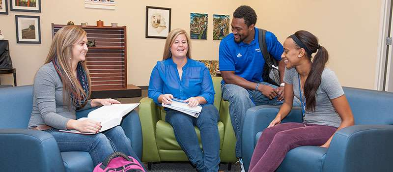 Four students meeting in the College of Business