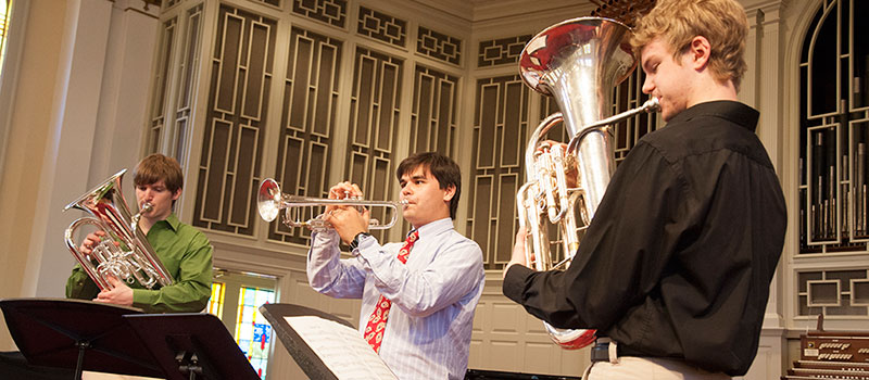 Students with brass instruments