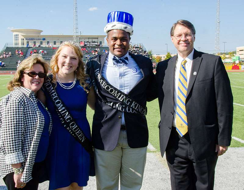Dr. and Mrs. Dowless with the Homecoming King and Queen.