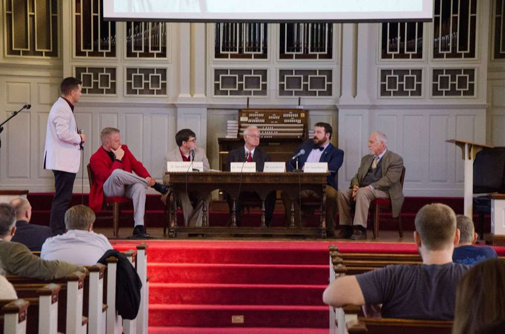 Panel members take part in a discussion at the end of the Reformation Day event.