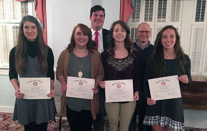 Honorees with their certificates.