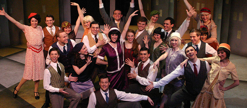 Group shot of cast from Thoroughly Modern Mille