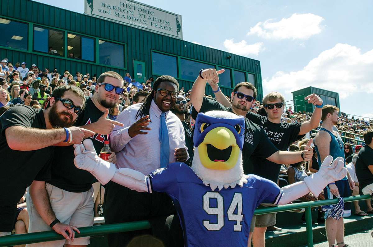 Fans and Hawk mascot at a football game